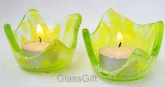 par de mini castiçais em vidro cor predominante: amarelo/incolor R$35,00