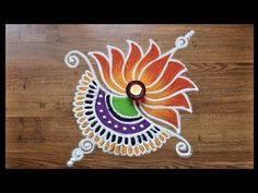 Rangoli designs with colours by Shital Daga/ lotus rangoli designs for Diwali Easy Rangoli Designs Diwali, Rangoli Simple, Indian Rangoli Designs, Rangoli Designs Latest, Simple Rangoli Designs Images, Rangoli Designs Flower, Free Hand Rangoli Design, Rangoli Border Designs, Small Rangoli Design