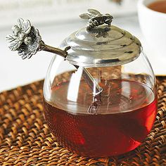 """Stonewall Kitchen:  Honey Pot with Bee Spoon - """"Add some whimsical charm to your breakfast table with this beautifully detailed Honey Pot. Made of high quality pewter and glass, it holds plenty of your favorite sweet honey and includes a delightful flower topped honey spoon for easy serving. Perfect for a breakfast buffet, displayed on an open shelf or as part of a centerpiece.""""  *  Want."""