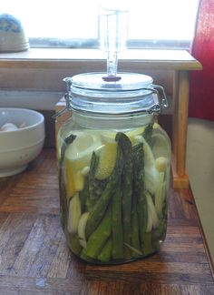 *Pickled Asparagus with Lemon*  2 lbs asparagus  Zest from 1 organic lemon  1/2 onion, sliced  2% salt water brine (19 gms of salt per 4 cups water)  Place asparagus in an appropriately sized jar (a 2L jar worked perfect for me). Tuck zest and onions between spears. Weigh down asparagus with a Dunk'R. Close the top and don't forget to add water to the airlock. Let set at room temp for about 5-7 days. Once activity dies down (no more bubbles), place in cold storage.  SEE LINK