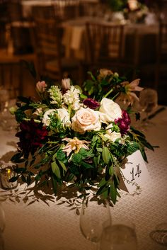 Ivory, Burgundy, and Green Centerpiece http://significanteventsoftexas.com