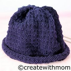If you're not keen on knitting in the round, here's a good pattern for a rolled brim hat knit on straights.