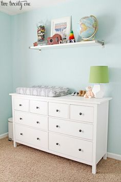 Perfect changing station on the dresser and shelf above. Cute lamp too.