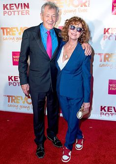 Susan Sarandon wore a blue suit, red and white sneakers, and a gold clutch on the red carpet with Sir Ian McKellen, wearing a black suit, light blue button up, and bright pink tie, at TrevorLIVE New York.