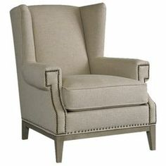 """Wingback arm chair with nailhead trim. Made in the USA.Product: ChairConstruction Material: Wood and fabricColor: Dove gray and naturalFeatures: Made in the USADistressed finishNailhead detailingDimensions: 39"""" H x 34"""" W x 39"""" D"""