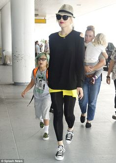 Busy mum: Gwen Stefani jetted out of New York City today with her sons Kingston, Zuma and an assistant by her side
