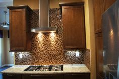 Our lastest beautiful kitchen remodel. love the glass tile backsplash and stainless hood Glass Tile Backsplash, Beautiful Kitchens, Animal Print Rug, Kitchen Remodel, Construction, Home Decor, Building, Interior Design, Home Interior Design