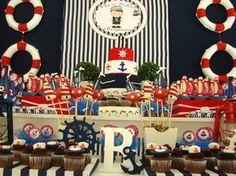 """Um charme a decoração deste chá de fralda com o tema marinheiros produzido pela Personnalité Festas e Eventos (clique)! Nenhum detalhe ficou de fora, as boias, ancoras e barquinhos nos doces e nas peças de decoração ficaram super charmosas além das cores: azul, branco e vermelho, não poderia ser mais """"navy"""", certo!? Adorei!!!! Ficha Técnica: Projeto, decoração, …"""