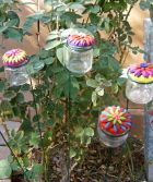 hummingbird feeders made from recycled baby food jars and fimo clay! wouldn't it be pretty to make the flower a red zinnia?