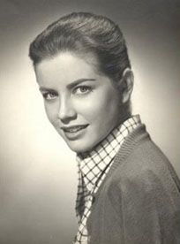 Dolores Hart c 1957. Dolores resembles the youngest daughter in the family, Catharine Holiday Prindle, and not just in looks.  Just as The Rev. Mother Dolores Hart is a stunning beauty who left Hollywood to become a nun, Holiday is a stunning beauty who gives herself to a different, decadent kind of religion:  paganism.  She's a combo Vestal Virgin and Druidic priestess and the High Priestess of the Tarot card.
