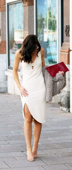 Winter white make the perfect holiday outfit! Pair a white bodycon dress with a fluffy fur jacket and a pop of color like fashion blogger Marie's Bazaar