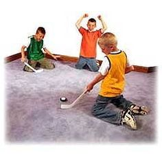 """Mini Carpet Hockey Set by Funslides by Simtec. $9.98. Mini Carpet Hockey! Develop your hockey skills and strategy with Mini Carpet Hockey. For lots of fun and fast action, play Mini Carpet Hockey safely indoors on carpet with your friends. The Carpet Puck has an ultra-smooth base that glides over any type of carpet and soft foam cleanly bounces off walls and basboards. Features: Two 16"""" Sticks and 1 Carpet Puck.Carpet Puck made of friction-resistant plastic that ..."""