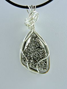 Sterling silver wire wrapped druzy pendant.