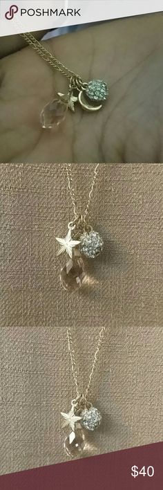A gold chain star, moon crystal circular necklace. A beautiful gold tone necklace with a star, moon, crystal circular ball , necklace. fashion jewelry Jewelry Necklaces