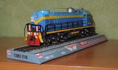 This train paper model is a PKP class SM48 (TEM-2 7114), a Soviet diesel locomotive operating in Poland for PKP, the Soviet-built version of the ALCO RSD-1
