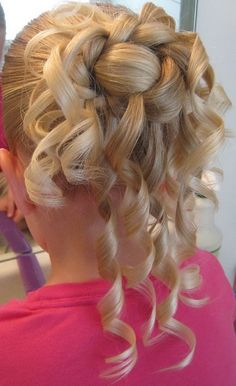 There are some cute and sweet little girls updos hairstyles maybe