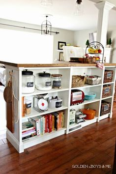 The bookshelf hack is kind of like the open shelving version of an island: The back is totally exposed and reveals organized compartments for baking supplies, books, and even snacks. See more at Golden Boys & Me »