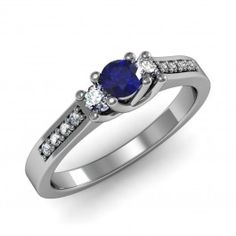 Blue Sapphire Round Three-Stone Ring set in 18K White Gold. (3.5mm)