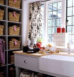 Stacks of labeled storage bins tuck muddy shoes and toys out of the way and keep this workstation neat and tidy. | Photo: Polly Wreford | thisoldhouse.com