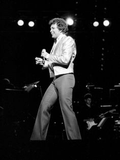"""Tom Jones finishes """"Flashdance"""" and then went into Billy Joel's """"Tell Her About It"""" during his sold-out concert March at the Grand Ole Opry House. Tom Jones Singer, Sir Tom Jones, Girls Toms, Grand Ole Opry, Billy Joel, Net Worth, Then And Now, Nashville, Have Fun"""