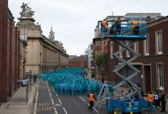 Naked volunteers, painted in blue to reflect the colours found in Marine paintings in Hull's Ferens Art Gallery, prepare to participate in US artist, Spencer Tunick's 'Sea of Hull' installation in Kingston upon Hull on July 9, 2016. Over a period of 20 years, the New York based artist has created over 90 art installations in some of the most culturally significant places and landmarks around the world including the Sydney Opera House, Place des Arts in Montreal, Mexico City, Ernest Happel…