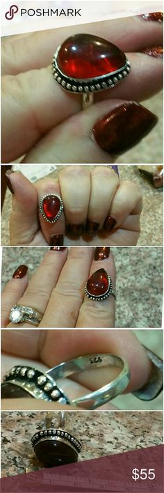 Genuine Red Garnet Cabochon Ring size 8.25 Beautiful Red Cabochon sits high up on this setting and glistens with flashes of bright red as ring moves. Set in 925 stamped Solid Sterling Silver. Please see all pictures for details. Brand New. Never Worn. Wholesale Price. Msrp 450.00 Jewelry Rings