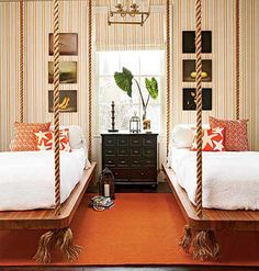These rope-hung bed platforms intrigue me: can they swing? The open floor gives a more spacious feel to the small room.
