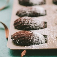 familystyle food: chocolate madeleines  1 tablespoon melted butter    10 tablespoons butter    6 ounces dark or bittersweet chocolate; chopped    1 1/2 cups powdered sugar    ½ cup all-purpose flour    ½ cup cocoa powder    ¼ teaspoon salt    6 egg whites