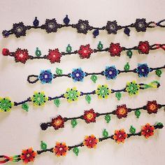 """More pretties from the Huichol collection unpacked yesterday, these skinny hand-beaded """"Daisy Chains"""" haven't made it into our online store yet, but just let us know which colors you want and they will be on their way to you. Artisan Jewelry, Handmade Jewelry, Daisy Chain, Beaded Flowers, Beads, Bracelets, Chains, Pretty, How To Make"""