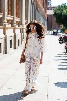 Womenswear Street Style. Eleonora Carisi wearing a white see-through maxi dress with Valentino bag at Missoni show. Photography by Ángel Robles. Fashion Photography from Milan Fashion Week.