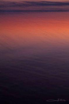 Sunrise Reflection on wet beach sand..