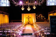 Concert venue is transformed for a wedding ceremony and later for the reception. #candles #weddingceremony #wedding #musicvenue #weddingvenue