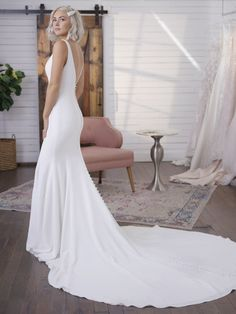 Maggie Sottero Fernanda minimalist chic, the jersey lining in this simple crepe fit-and-flare wedding dress Crepe Wedding Dress, Simple Wedding Gowns, Minimalist Wedding Dresses, Maggie Sottero Wedding Dresses, V Neck Wedding Dress, Fit And Flare Wedding Dress, Classic Wedding Dress, Long Sleeve Wedding, Crepe Dress