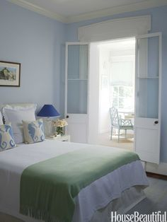 """Master Bedroom WALL COLOR!  The master bedroom is a sea of blue and green calm. """"I bring those beautiful colors of the Caribbean into every room,"""" Morgan says. """"I love the idea of being at the beach wherever I am."""" WALLS are painted BENJAMIN MOORE'S MOUNTAIN MIST. Seahorse pillows and throw from Number Four Eleven."""
