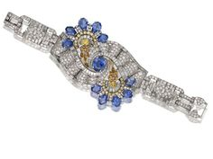An impressive artdeco sapphire, diamond and colored diamonds bracelet, by OscarHeyman, circa #1940 - Sold for $80,631 through #Bonhams.