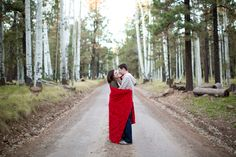 Engagement photos in the mountains!  Beautiful fall colors, cool weather and a couple in love.  Flagstaff, AZ  Sadie Such Photography and Films