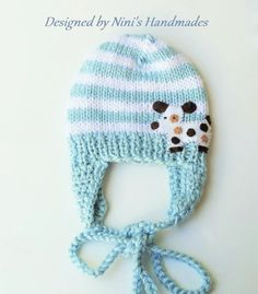 Colors: Light blue and White striped with Dog applique I have hand knitted this sweetheart in a very soft baby yarn, and embellished it with my felt design This Hat was knitted in an smoke free enviro