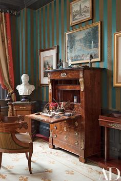 """An Empire secrétaire à abattant and a bust of Napoléon stand in the guest room; the walls are covered with a Claremont stripe. Fernanda Kellogg and Kirk Henckels's New York City Apartment : Architectural Digest"" Park Avenue Apartment, New York City Apartment, Striped Room, Striped Walls, Deco Studio, Antique Interior, Traditional Bedroom, Traditional Dining Rooms, Classic Interior"
