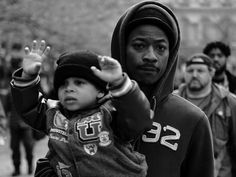 A father and son march on April 23. // Photos from Freddie Gray protests in Baltimore