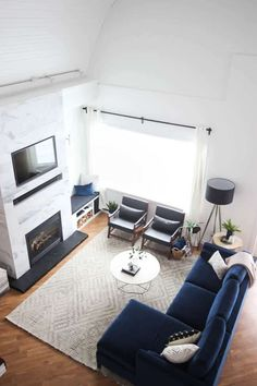 This gorgeous Modern Living Room reveal is finally here! This space came a long way from an outdated, empty space in this beautiful barn home. Love all of the contemporary DIY and decor ideas in this Blue Couch Living Room, Living Room Modern, Rugs In Living Room, Living Room Decor On A Budget, Living Room Decor Colors, Diy Interior, Home Design, Tiled Fireplace, Decorative Fireplace