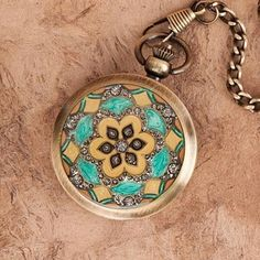 """This beautiful pocket watch has an antique brass finish and is adorned with faux stones and crystals on the front depicting a floral motif. Measures 1-3/4"""" across. A matching 12"""" chain with vest clip is included. This piece has a flip-open lid. No steampunk outfit is complete without a period timepiece to accompany it! #pocketwatch #homedecor"""