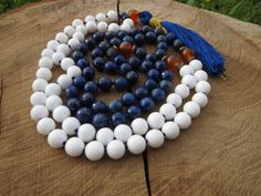 Check out this item in my Etsy shop https://www.etsy.com/listing/235315044/108-meditation-mala-lapis-lazuli-jade