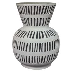 • Sturdy terra cotta construction<br>• Matte glaze<br>• High-contrast design<br><br>The Ceramic Vase with Lines - White - Threshold adds a special, hand-made touch to your décor. Made of terra cotta and fired to a rich, matte finish, the black stripe pattern adds texture and visual interest. It blends well with any décor from mid-century modern to contemporary. Perfect for cut flowers or dried flowers.