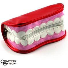 Smiling teeth! Who thought they could make a small carry bag from a smiling mouth? What a wonderful and whimsical gift for the dental professional in your life.