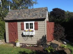 The cutest DIY garden shed ever made completely from scratch in a saltbox design