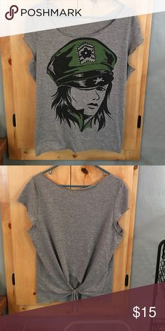 """girl power!!! vintage army tee loose fitting vintage tee. there isn't a tag stating size fits like a large very cute for any size though depending on how you want it to fit. no stains or tears. I purchased it """"cut"""" around the neck, sleeves, bottom, and back of shirt unsure if it was made this way or someone got creative but its really cute!! Tops Tees - Short Sleeve"""