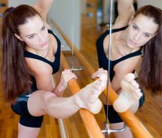 10 Dance-Inspired Fitness Classes You Have to Try // dancer stretching on barre c Corbis