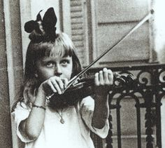 Huguette Clark (a reclusive multi-millionaire) was trained to play the violin at a young age. Here, she plays one on a balcony in Paris. ~ETS  (Huffington Post)