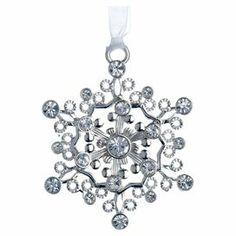 "Silver-plated snowflake ornament adorned with Swarovski crystal accents and a white organza hanging ribbon. Made in the USA.  Product: OrnamentConstruction Material: Silver plate and Swarovski crystalsColor: SilverFeatures:  Made in the USAIncludes a white organza ribbon for hangingElegantly packaged for gift-giving and storage Dimensions: 3"" H x 2.5"" W x 0.25"" D"