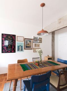The lighting marks this cozy renovated apartment with Kitchen Dining, Dining Room, Dining Table, Red Tiles, Lunch Room, Colorful Chairs, Cozy Living Rooms, Wooden Flooring, Frames On Wall